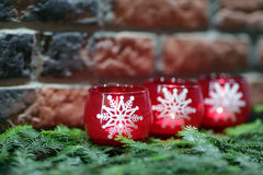 Three candles with white snowflakes. Christmas decoration: Three candles with white snowflakes Royalty Free Stock Images