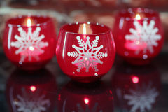 Three candles with white snowflakes. Christmas decoration: Three candles with white snowflakes Stock Photos