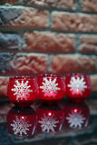 Three candles with white snowflakes. Christmas decoration: Three candles with white snowflakes Stock Photography
