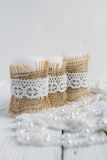 Three candles on white table. Three candles in rustic style, with lace on a white table Royalty Free Stock Photos