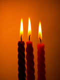 Three Candles On Yellow Royalty Free Stock Photography