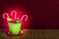 Three candy canes with Christmas tree balls royalty free stock image