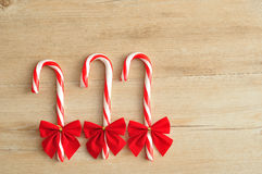 Three candy canes with red bows Royalty Free Stock Photo