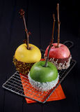 Three candy coated apples for Halloween stock photo