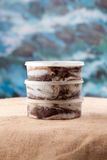 Three canned of anchovies, small fish, sardines. Close-up sacking and blue background royalty free stock photo