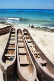 Three Canoes. Stylish canoes on San Miguel town beach (Cozumel island, Mexico royalty free stock images