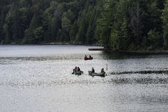 Three canoes heading out Stock Images
