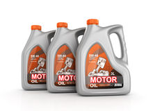 Three cans of motor oil Stock Images