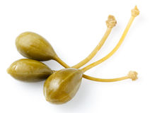Three caper berries,  on white Royalty Free Stock Images
