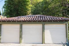 Three car garage Stock Images