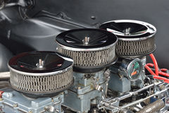 Three carburetor close up. Three carburetor of car engine close up Royalty Free Stock Images