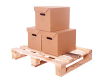 Three cardboard boxes on Wooden palette Stock Photos