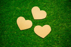 Three cardboard hearts on the grass. Cardboard hearts on the grass stock images