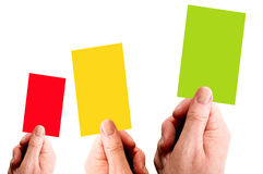 Three Cards. Hands holding red, yellow and green cards royalty free stock photo
