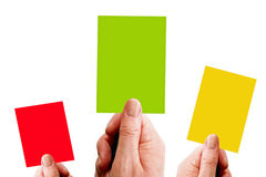 Three Cards. Hands holding red, yellow and green cards isolated over white stock photos