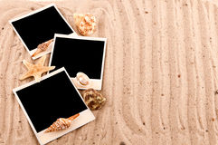 Three cards lie on the sand with Stock Photography