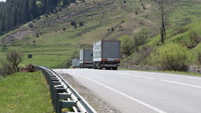 Three cargo truck go on road stock video footage