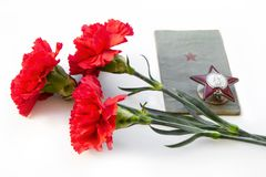 Free Three Carnations, The Order Of The Red Star, A Military Book On A White Background. Items Stock Photography - 141075002