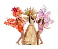 Three carnival dancer women dancing against Stock Images