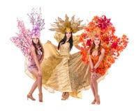 Three carnival dancer women dancing against Stock Image