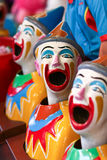 Three carnival laughing clowns. Carnival sideshow with the three laughing clowns with turning heads Royalty Free Stock Photography