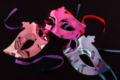 Three carnival masks on dark background Stock Photos