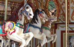 Three carousel horses Stock Photos