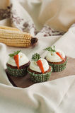 Three carrot cupcakes. Image of three carrot cupcakes with old style decoration Royalty Free Stock Image