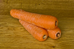 Three carrots Stock Photos