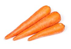 Three carrots isolated Stock Images
