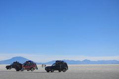 Three cars with people in Salar de Uyuni Royalty Free Stock Image