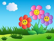 Three cartoon flowers on meadow Royalty Free Stock Photography
