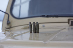 Three cartridge cases on bonnet. yellow colour. close up Royalty Free Stock Image