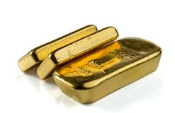 Three cast gold bars, the typical form of bullion gold bullion. royalty free stock images