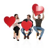 Three casual people sharing the love royalty free stock photo