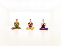 Three casual people yoga class Stock Image