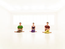 Three casual people yoga class Royalty Free Stock Photos