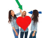 Three casual women showing their big heart with arrows Stock Photo