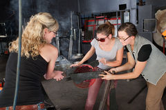 Three Artists Working with Hot Glass Stock Photos