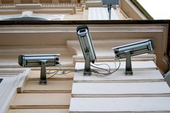 Three cctv security cameras Stock Photos