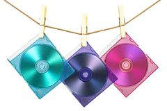 Three CDs in coloful cases fix. Ed with pins on the line Royalty Free Stock Photo