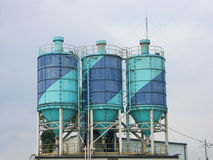 Three cement silos Royalty Free Stock Photography