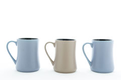 Three ceramic cup with handle Stock Photos