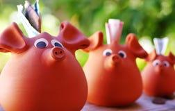 Three ceramic piggy Stock Images