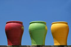 Three Ceramic Pots. 3 ceramic pots - colorful and glazed against ble sky stock photography
