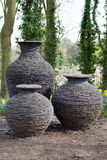 Three ceramic textured vases in an outdoor garden. Three ceramic textured vases in an outdoor publi garden in North England Royalty Free Stock Image