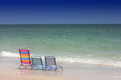 Three Chairs. Three Beach Chairs at the oceans edge. Florida's Gulf Coast royalty free stock image