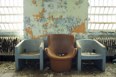 Three Chairs in Abandoned Building Royalty Free Stock Images