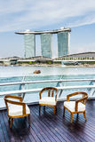 Chairs on a Balcony in Singapore. Three chairs on a balcony in Singapore Stock Photos
