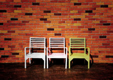 Three chairs with beautiful red brick wall background Royalty Free Stock Image